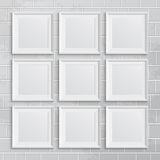 Set of square picture frames on brick wall Stock Photography
