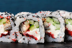 Set of square sushi rolls with vegs, cream cheese and red roe on Royalty Free Stock Photos