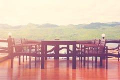 Set stół i krzesła na drewnianej podłoga Zdjęcie Stock