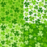 Set of St. Patrick`s day vector seamless backgrounds with shamrock. Royalty Free Stock Photography