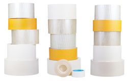 Set of stacks of adhesive tape rolls isolated on white Stock Images