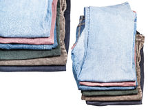 Set of stacks of various jeans and corduroys Royalty Free Stock Image