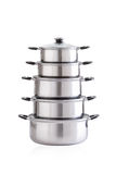 Set of stainless pots with glass lids Royalty Free Stock Images