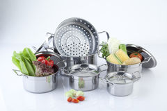 Set of stainless pots and lids Royalty Free Stock Photos