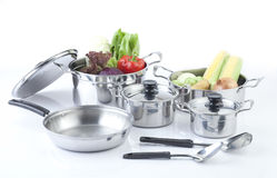 Set of stainless pots with lids Royalty Free Stock Image