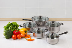 Set of stainless pots and pan Royalty Free Stock Photos