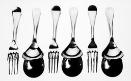 Set of stainless steel fork and spoon. Set of stainless steel fork and spoon reflection on white background Royalty Free Stock Image