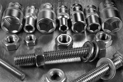 Set of stainless steel hex sockets with bolts nuts and washers o Stock Photography