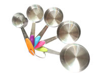 Set of stainless steel measuring spoons on white background Royalty Free Stock Images
