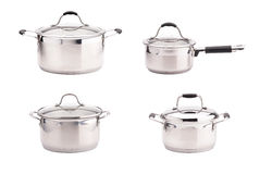 Set of stainless steel saucepans isolated on white background. Set of different stainless steel shiny saucepans with covers isolated on white background Royalty Free Stock Images