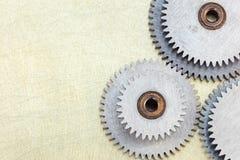 Set stalowi gearwheels na przemysłowym porysowanym tle Fotografia Stock