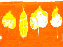 Set of stamped dry leaves on orange Stock Photo