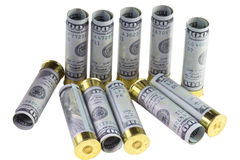 Set of standing and lying transparent plastic 12 caliber hunting shotgun shells loaded with hundred us dollars bills. Stock Photo