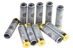 Set of standing and lying transparent plastic 12 caliber hunting shotgun shells loaded with hundred us dollars bills. Five shells standing, six cartridges Stock Photo