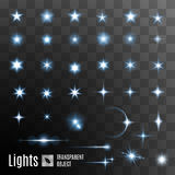 Set of stars shining. Set of glowing light effect stars bursts with sparkles on transparent background Royalty Free Stock Photos