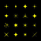 Set of stars, sparkle, glint, gleam, etc. Vector illustration on a black background. Light stars with rays, explosion, fireworks Stock Images