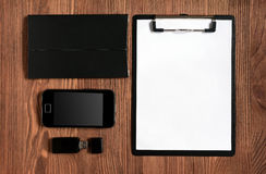 Set of stationery with clipboard, notepad, smartphone and flash driver Royalty Free Stock Photography