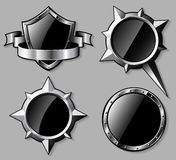 Set of steel glossy shields and compass roses Royalty Free Stock Image