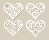 Set stencil lacy hearts with carved openwork pattern Royalty Free Stock Photos