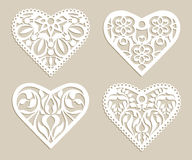 Set stencil lacy hearts with openwork pattern Stock Image