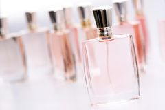 The set of step & repeat of Pink perfume bottle. The Pink perfume bottle atand in front of other one Stock Photo