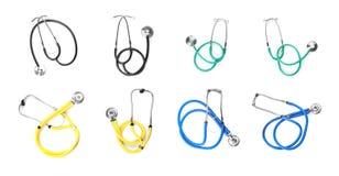 Set with stethoscopes on white background. Medical objects stock photos