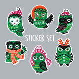 Set of stickers with Christmas owls in knitted hats, scarves Stock Photography