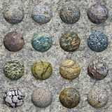 Set of stone balls on granite - seamless texture. A set of stone balls against a granite wall - seamless texture Royalty Free Stock Images