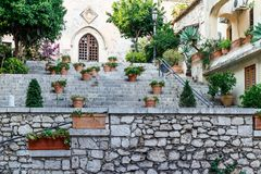 Set of stone steps with decorative potted plants stock photography