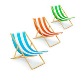 Set of stripped deck-chairs beach inventory Royalty Free Stock Photo