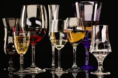 A set of strong alcoholic beverages in glasses, in the presence of whiskey, vodka, rum, brandy, tequila, on a dark background stock photos