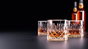 A set of strong alcoholic beverages in glasses, in the presence of whiskey, vodka, rum, brandy, tequila, on a dark background royalty free stock images