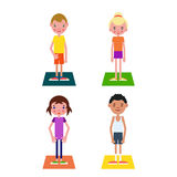 Set of students who are ready to begin physical education classe. S which stand on gym mats Royalty Free Stock Photos