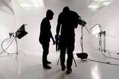 On the set in the studio. Silhouette of people working in video studios royalty free stock photography