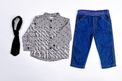 Set of stylish clothes for toddler boy. Stock Photos
