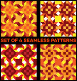 Set of 4 stylish geometric seamless patterns with rhombus, triangles and squares of yellow, red, vinous, orange, white and cherry Royalty Free Stock Image