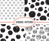 Set of stylish hand drawn polka dot seamless patterns. Royalty Free Stock Images