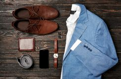 Set of stylish male clothes and accessories. On wooden background Stock Photography
