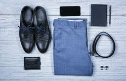 Set of stylish male clothes and accessories. On wooden background Royalty Free Stock Photography