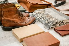 Set of stylish male hipster accessories and boots. On wooden background Stock Photography