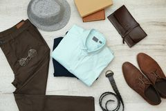 Set of stylish male hipster clothes. On wooden background Stock Photo