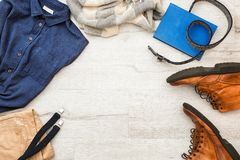 Set of stylish male hipster clothes. On wooden background Stock Images
