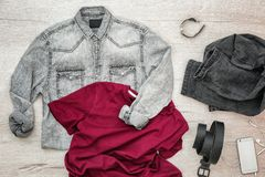 Set of stylish male hipster clothes. On wooden background Royalty Free Stock Photo