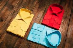 Set  of stylish new bright colorful men's shirts Royalty Free Stock Photos