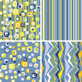 Set of stylish seamless ornaments. Set of zigzag, strip and polka dots backgrounds in blue and yellow colors Stock Photos