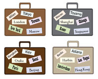 Set of stylish travel suitcases. Suitcase with tourist stickers in different colors Royalty Free Stock Photos