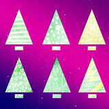 Set of stylized christmas trees. Simple form. Triangle and rectangle.  Royalty Free Stock Photography