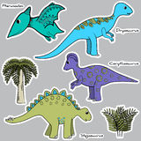 Set of stylized dinosaur stickers Stock Images