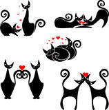 Set of stylized figures of cats. Isolated funny figurines of cats with hearts for Valentines Day Royalty Free Stock Photo