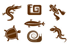 Set of stylized graphic images of amphibians, reptiles, snails, fishes in tribal style. Set of stylized graphic of brown images on a white background amphibians Royalty Free Stock Images